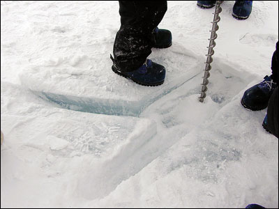 Drilling the sea ice to test the thickness