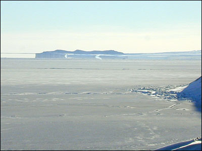 The part of the photo between the sea ice and the  												 horizontal line above it is a Fata Morgana. The actual  												 horizon is the upper line.