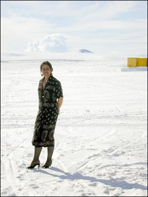 Irma on the ice in a silk dress & high heels